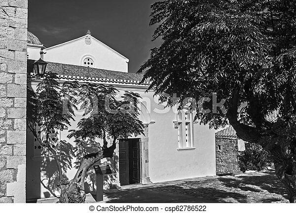 black and white photography of the church of Elkomenos Christos at Monemvasia Greece - csp62786522