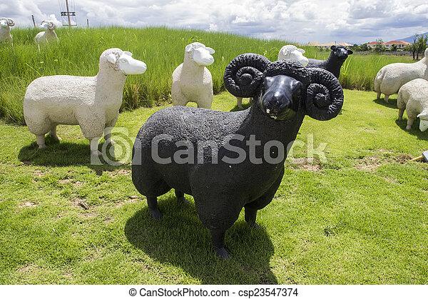 black and white sheep statue - csp23547374