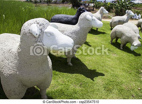 black and white sheep statue - csp23547510