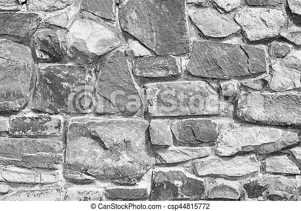Black and white stone wall - csp44815772