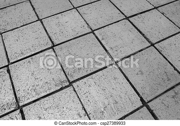 Black and white tiles give a harmonic pattern at the ground - csp27389933
