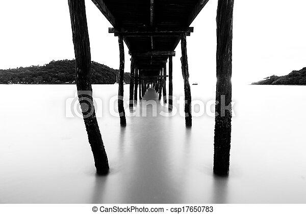 Black and white wooden bridge - csp17650783