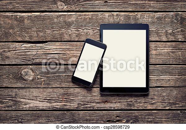 Black Apple devices - Iphone 6 plus and Ipad Air  - csp28598729
