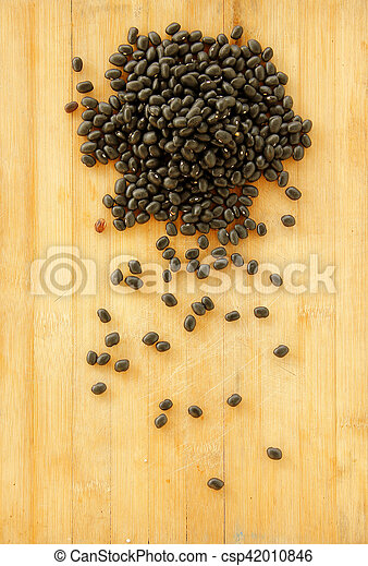black beans are on wooden background. - csp42010846