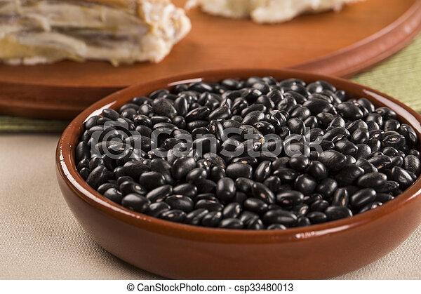 Black beans on wooden background - csp33480013