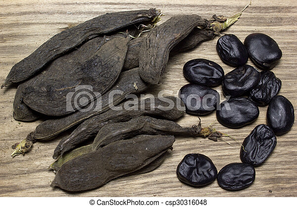 Black beans on wooden background - csp30316048