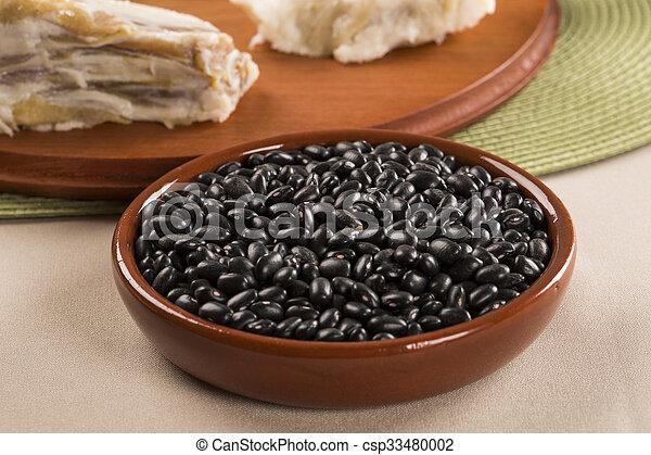 Black beans on wooden background - csp33480002