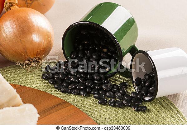 Black beans on wooden background - csp33480009