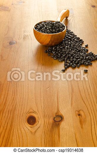 Black beans on wooden background - csp19314638