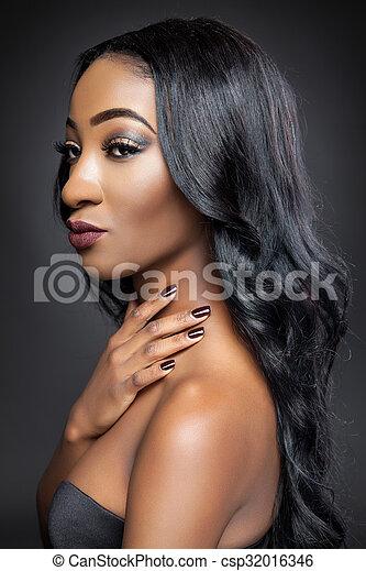 Black beauty with elegant long hair - csp32016346
