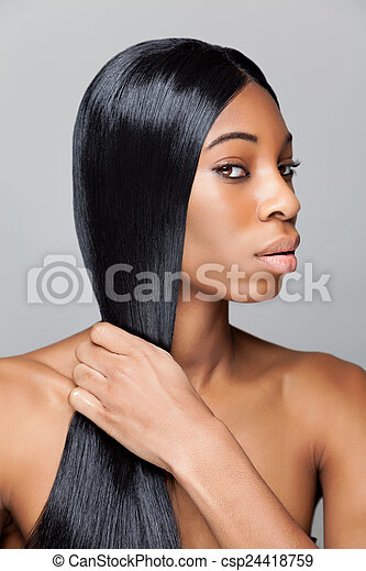 Black beauty with long straight hair - csp24418759