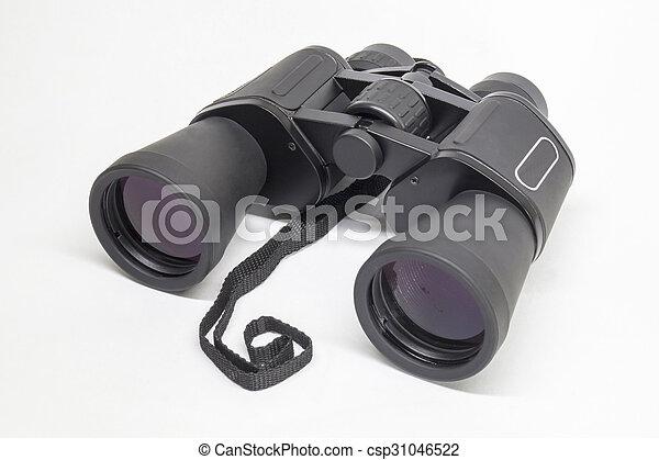 Black binoculars insulated on light background - csp31046522