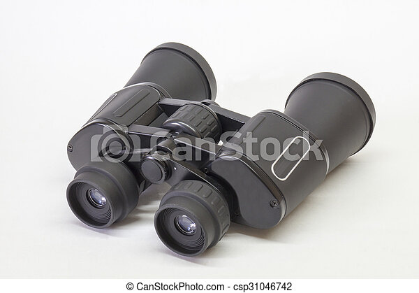 Black binoculars insulated on light background - csp31046742