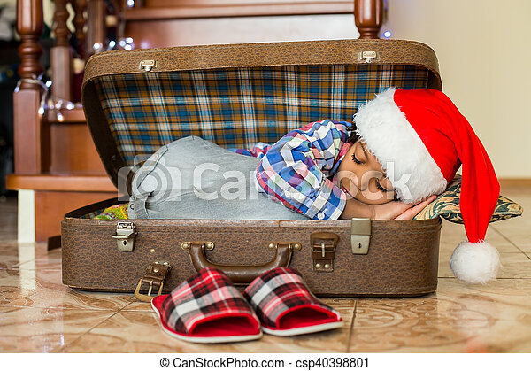 Black boy sleeps in suitcase. - csp40398801