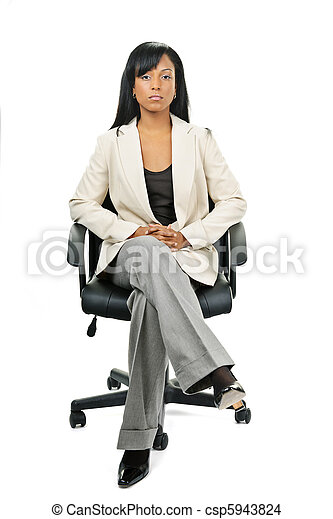Black businesswoman sitting in office chair - csp5943824