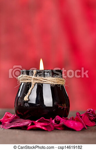 Black candle cup on red background - csp14619182