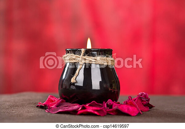Black candle cup on red background - csp14619597