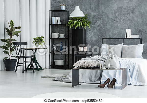 Black chair in bright bedroom