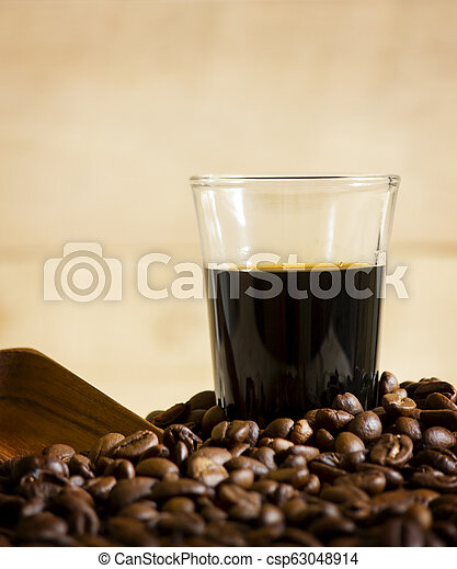 Black coffee cup and Coffee beans on wooden background. - csp63048914