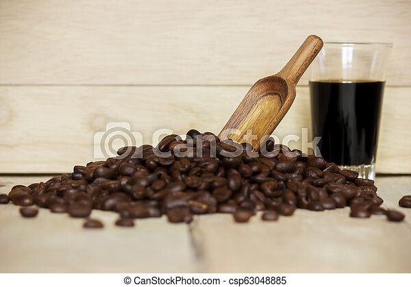 Black coffee cup and Coffee beans on wooden background. - csp63048885
