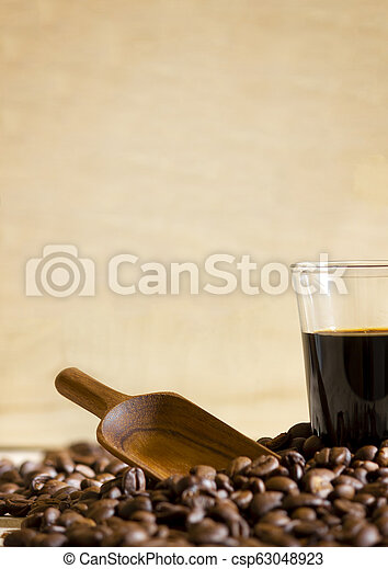 Black coffee cup and Coffee beans on wooden background. - csp63048923