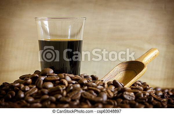 Black coffee cup and Coffee beans on wooden background. - csp63048897