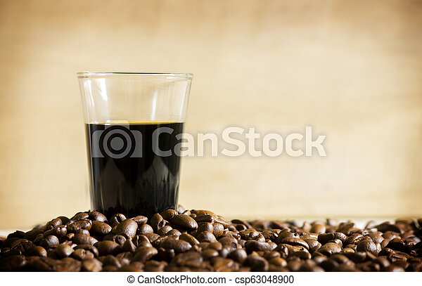 Black coffee cup and Coffee beans on wooden background. - csp63048900