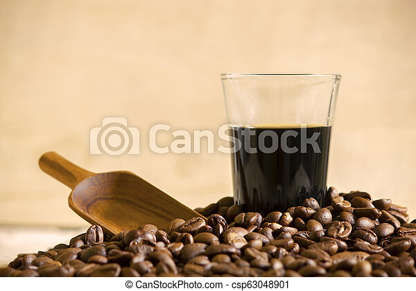 Black coffee cup and Coffee beans on wooden background. - csp63048901