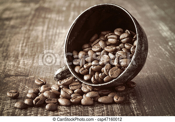 Black coffee cup and coffee beans - csp47160012