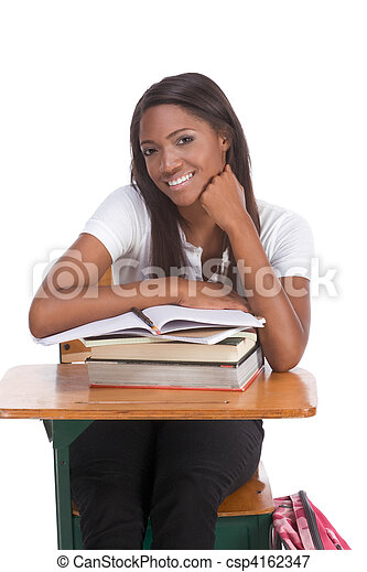 Black college student woman with book by desk - csp4162347