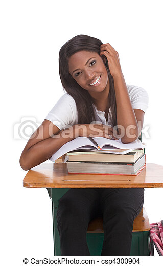 Black college student woman with book by desk - csp4300904