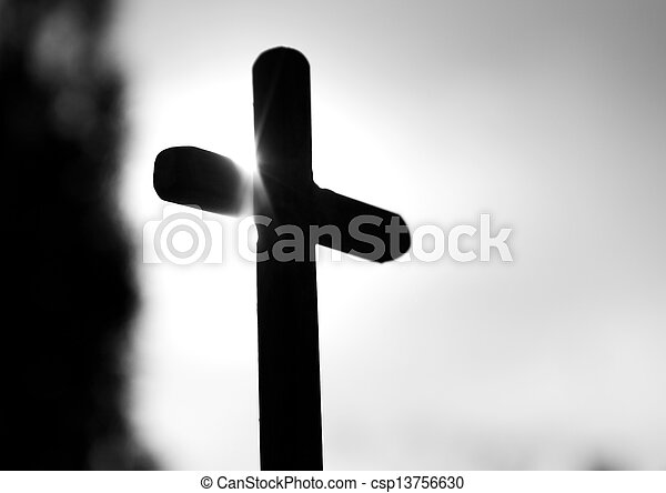 black cross in the setting sun - csp13756630