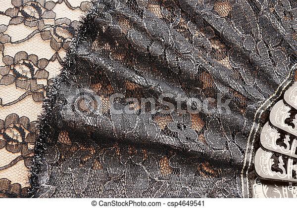 Black fan on a background a lace - csp4649541