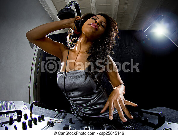 Femme Dj black female dj. young african american female dj playing music at a
