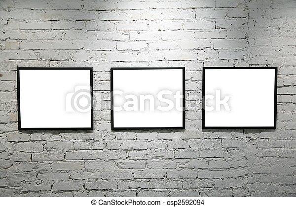 black frames on white brick wall 2 - csp2592094