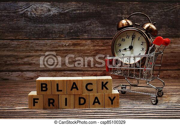 Black Friday message alphabet letter on wooden background - csp85100329
