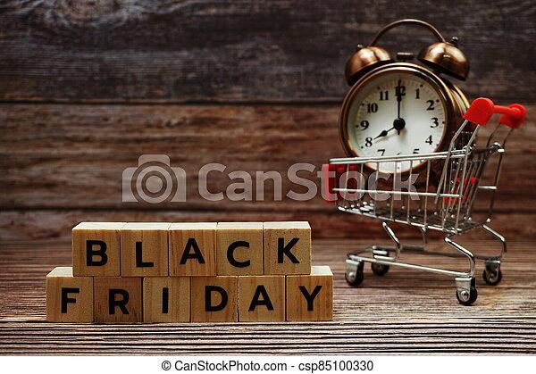 Black Friday message alphabet letter on wooden background - csp85100330