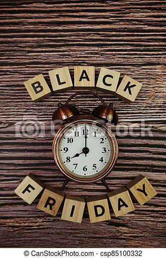Black Friday message alphabet letter on wooden background - csp85100332