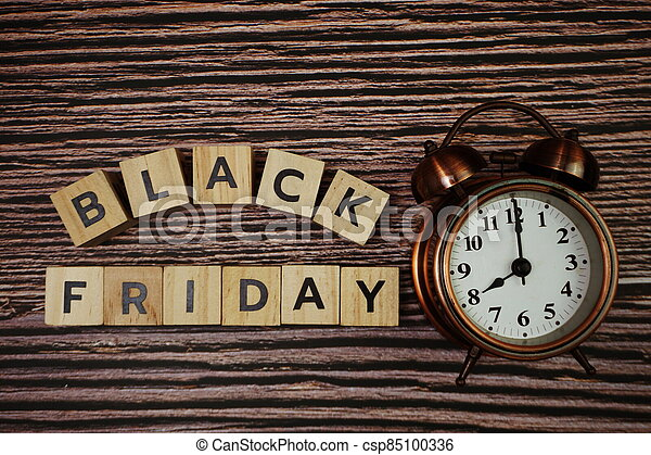 Black Friday message alphabet letter on wooden background - csp85100336