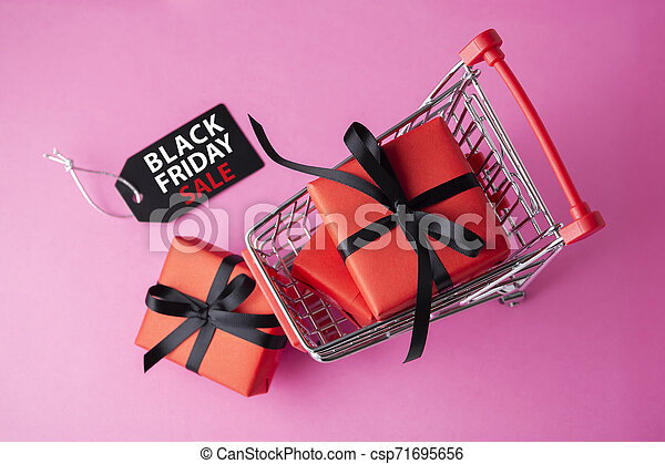 Black friday sale label with red gift box on pink background - csp71695656