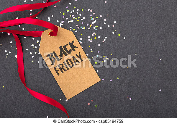 Black friday sale tag with red ribbon - csp85194759