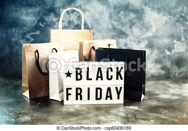 Black friday sale word on lightbox on dark table top view - csp60436189