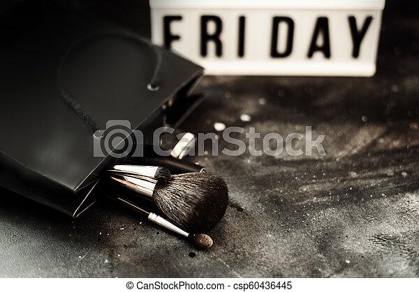 Black friday sale word on lightbox on dark table top view - csp60436445