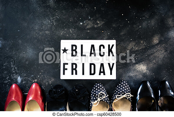 Black friday sale word on lightbox on dark table top view - csp60428500
