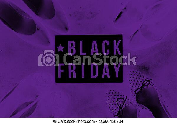 Black friday sale word on lightbox on dark table top view - csp60428704