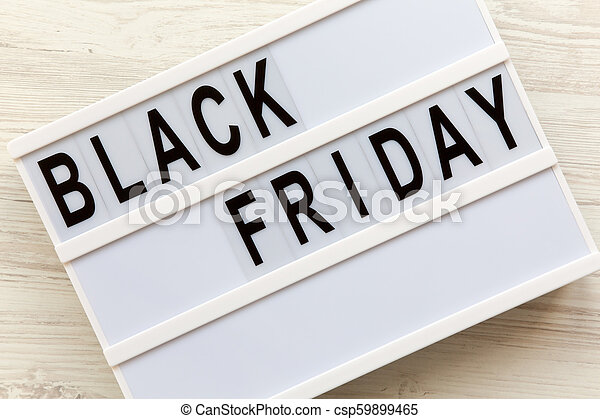 'Black Friday' word on lightbox over white wooden background, top view. Flat lay, overhead, from above. - csp59899465