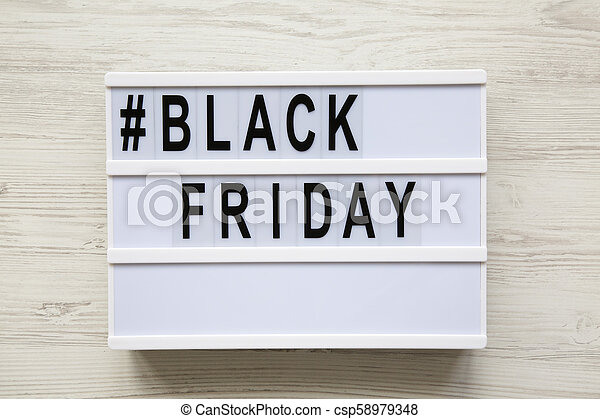 Black friday word on modern board over white wooden background, top view. - csp58979348