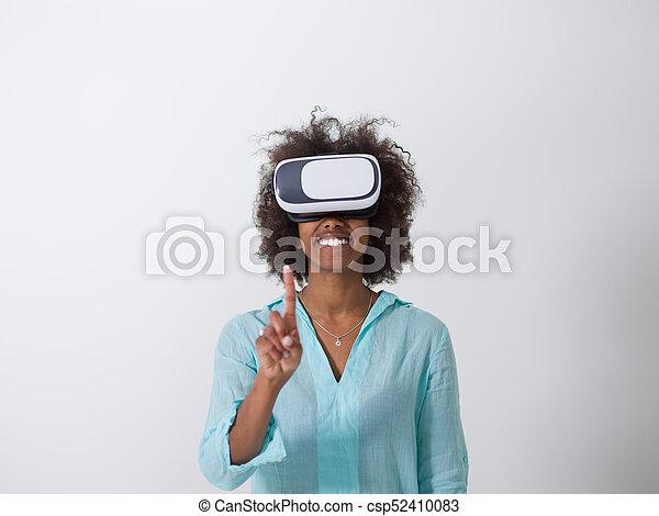 6c8109b6222d black girl using VR headset glasses of virtual reality - csp52410083