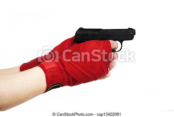 Black gun in a hand - csp13422081
