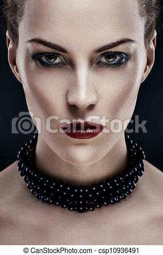 black hair young woman portrait, studio shot - csp10936491